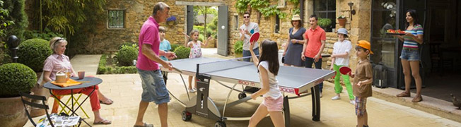 Family playing table tennis